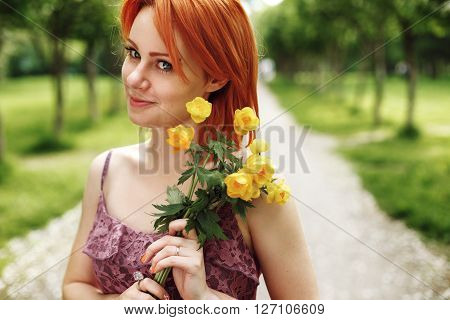Red Heair Woman Holding Spring Flowers