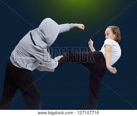 Girl reflects attack robber on the blue background