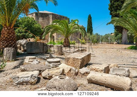 Pillars and columns near Basilica of Agios Titos. Gortyna. Crete Greece poster