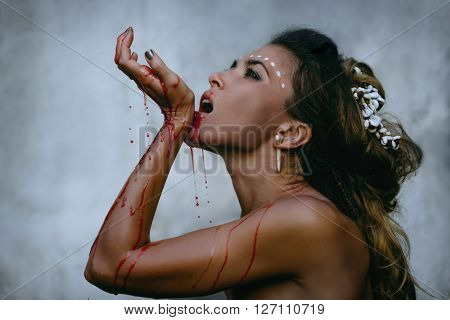 lamorous photos of wild woman showing blood and gore dripping from the mouth