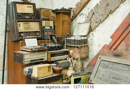 CHIANG MAI, THAILAND - FEB 26, 2016: Vintage radio receptor and some other antiques and old electronic devices inside antique shop on February 26, 2016. King Mengrai founded the city of Chiang Mai in 1296