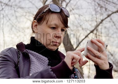 Young woman reading email on a mobile phone, smartphone