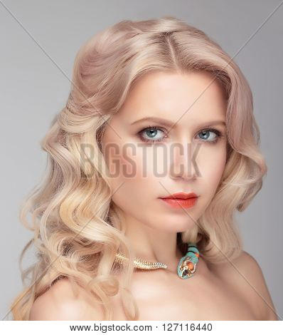 Model With Natural Make Up And Blonde Hair.
