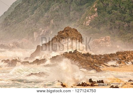 Huge waves whipping up spume at sunrise along the Eastern Cape coast of South Africa