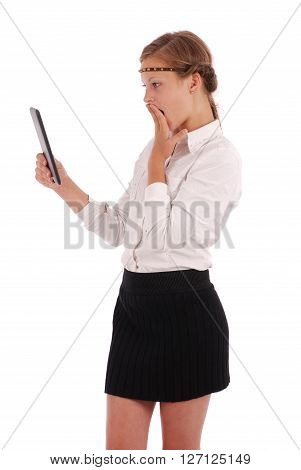 Girl with surprise is looking at tablet pc isolated on white
