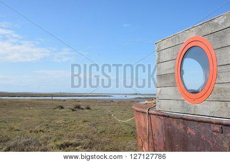 Houseboat overlooking deserted estuary east anglia england