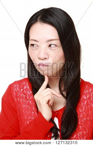 Japanese woman worries about something on white background