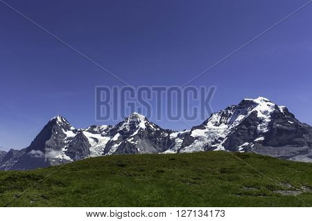 The famous three mountains Eiger, Moench, and Jungfrau in the Bernese Oberland, Switzerland