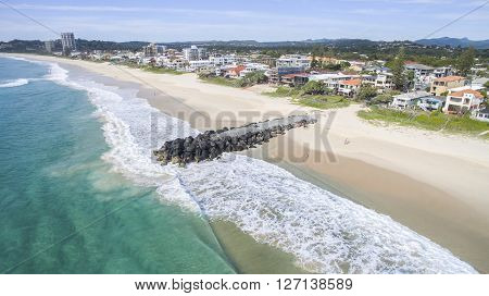 Aerial view of Gold Coast Palm Beach and tidal break facing south