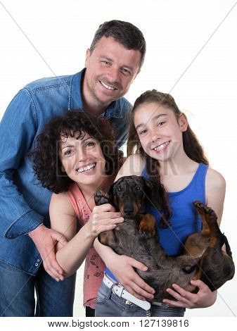 Loving and smiling family with young girl and her dog isolated