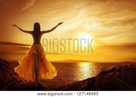 Calm Woman Meditating on Sunset Beach Relax in Open Arms Pose