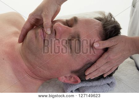 Therapist Applying Pressure With Thumbs On Forehead.