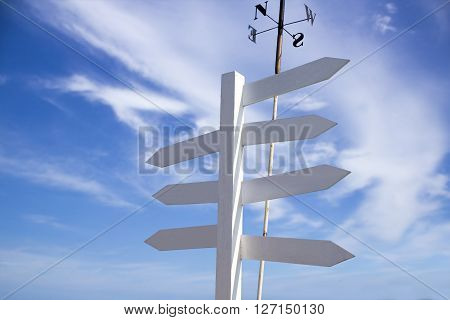 Blank directional road signs with blue sky