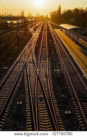 Railway Tracks at the train station at sunset. high angle