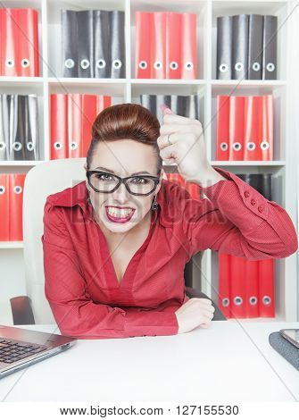 Angry Business Woman Shaking Big Fist In Office