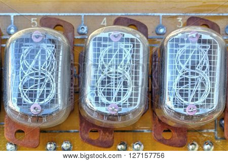 Electronic circuit board with old style indicator tubes closeup