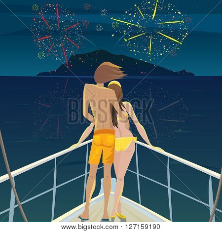 Young man and a beautiful girl standing on the deck at night and admire the fireworks over the island - Celebration or Festival concept