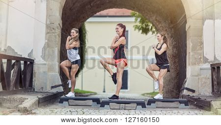 girls stepping on exercising steeper outdoor