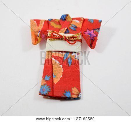 Mini decorative origami red paper kimono with white sash
