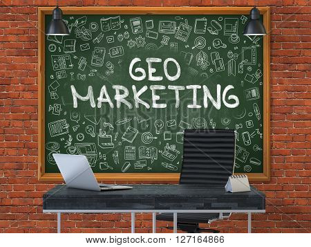 Geo Marketing - Handwritten Inscription by Chalk on Green Chalkboard with Doodle Icons Around. Business Concept in the Interior of a Modern Office on the Red Brick Wall Background. 3D.