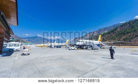 PARO BHUTAN - March 2 2016: People arriving at Paro airport Bhutan with druk air the