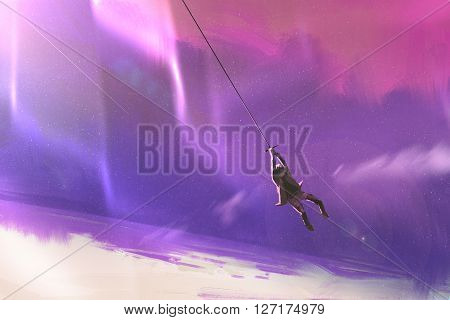 the man hanging on a rope swing above the planet earth