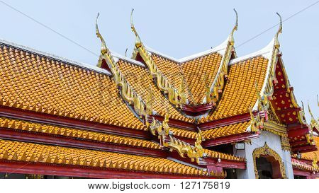 Thai temple ceramic roof with Thai style building eaves and tympanum. Bangkok Thailand