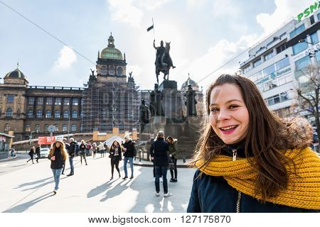 A girl  at the Wenceslas Square in Prague