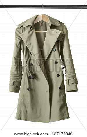 Khaki cotton trench coat on clothes rack isolated over white