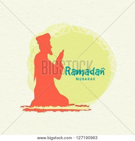 Religious Muslim man reading Namaz (Islamic Prayer) on occasion of Holy Month of Prayers, Ramadan Mubarak celebration.