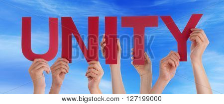 Many Caucasian People And Hands Holding Red Straight Letters Or Characters Building The English Word Unity On Blue Sky