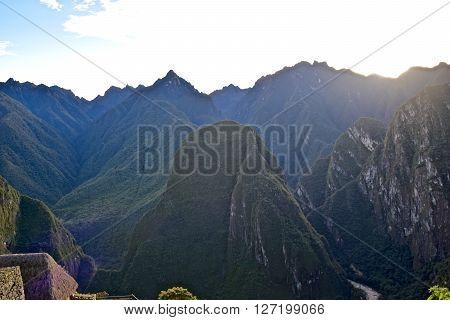 Sunrise over Westward mountain range from inside Machu Picchu city.