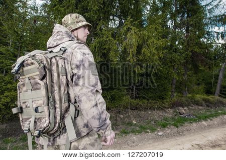 Forest Ranger at Work. Caucasian Forest Ranger Wearing Camouflage.