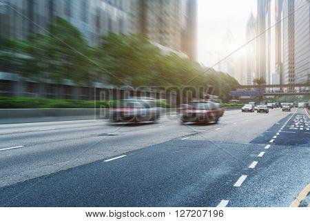motion traffic,city buildings background,hongkong china.
