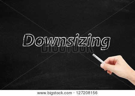 Downsizing written on a blackboard