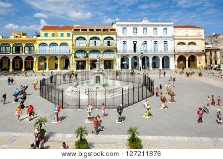HAVANA,CUBA- APRIL 20,2016 : Tourists and cubans at colorful colonial Old Square in the heart of Old Havana