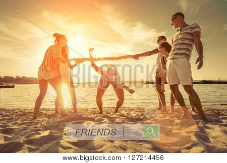 Friends funny game on the beach under sunset sunlight.