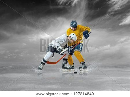 Ice hockey players in action outdoor around mountains
