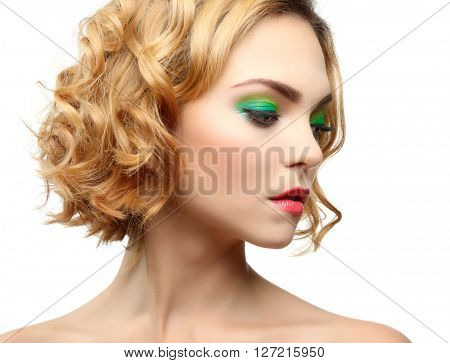 Beautiful girl with colorful makeup, isolated on white
