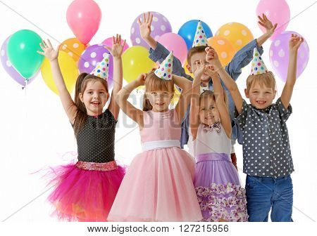 Happy group of children with having fun at birthday party, isolated on white