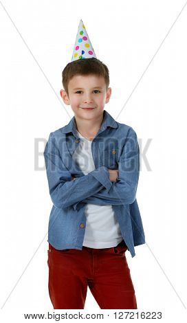 Little cute boy in birthday cap, isolated on white