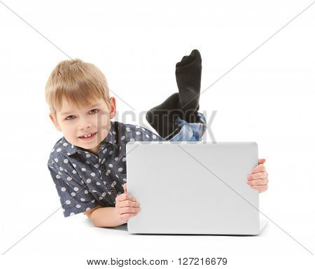 Little boy with laptop isolated on white