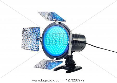 portable lighting for video with a blue filter in working condition from the power supply