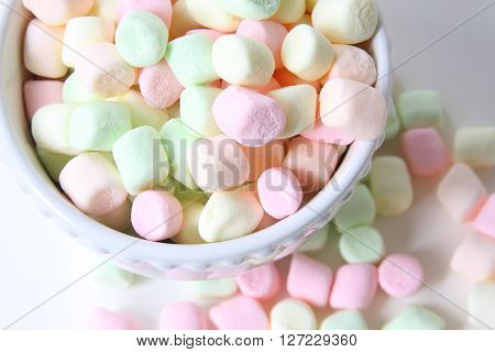 pastel colored mini marshmallows, isolated on white background