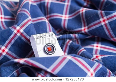 Cloth label advice for your laundry. label with instructions over