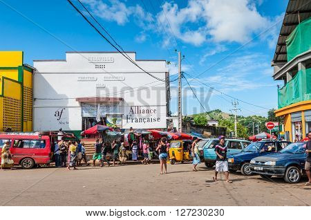 Hell Ville Madagascar - December 19 2015: Malagasy people near the Municipal Theatre in Hell Ville a town at the Nosy Be island North of Madagascar. Built in 1954.