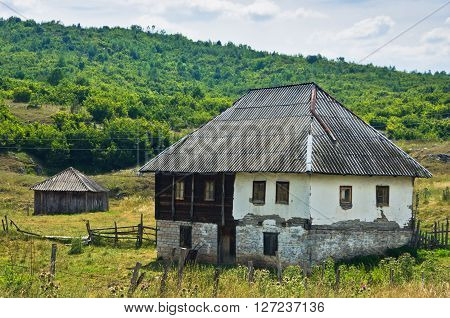 Old style stone and wood house at Pester plateau in southwest Serbia