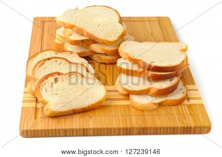 cut bread on breadboard isolated on white background