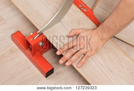 Red tool for cutting laminate on a laminate floor