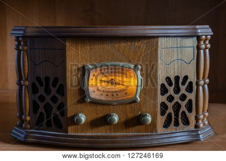 antique radio on a wooden vintage background